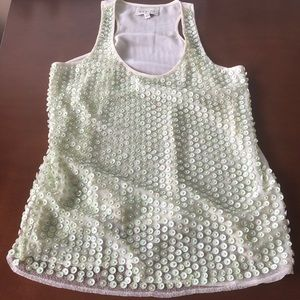 Sabine ivory tank with light green beaded detail.
